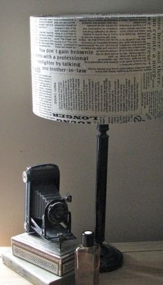 Things to do with a newspaper: decorate a lampshade. #DIY