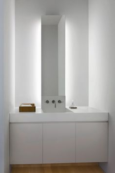 Bathroom with indirect lighting. Fairview Townhouse by Bucchieri Architects.