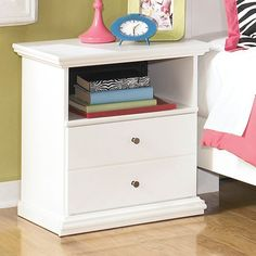 A finish of crisp white adds timeless style to this vintage night stand from Signature Designs by Ashley.