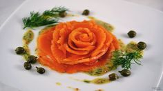 Gravlax rose with capers, hovmastarsas (I assume), and dill