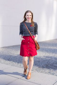 Cute Valentine's Day Tops That You Can Also Style For Work | Something Good, @danaerinw , , women, fashion, clothing, style, women's fashion, women's clothes, blue and white striped shirt, striped shirt, hearts, valentine's day, valentine's day outfit, outfit inspiration, red skirt, scalloped skirt, ankle boots, cognac booties, crossbody bag, cognac purse  #clothing #style #womensclothing #valentinesday #valentinesdayoutfit #talbots #jcrew #jcrewfactory