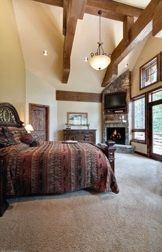 high ceilings and wood beams! a lovely master bedroom