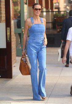 One and done: Heidi Klum managed to make a pair of overalls look very sexy in New York on Wednesday