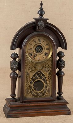 Walnut mantel clock, ca. 1900