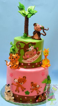 Jungle Theme For Girl Baby Shower Cake - Toppers and decorations are made from gumpaste. Marble cake bottom, red velvet top, covered with marshmallow fondant. CAKE BY: YARI GONZALEZ POOPASCOOPA ON CAKECENTRAL.COM www.facebook.com/cakesbyyari