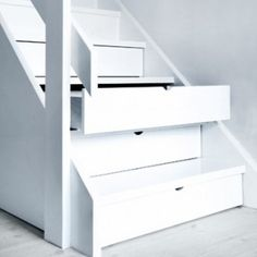 Practical use of storage within stair treads. http://www.koekkenskaberne.dk/o09_undertrappen.htm