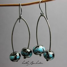 Turquoise blue glass Lampwork bead earrings ~ These earrings feature two lampwork beads that I have handmade in my glass studio. The glass is a very pretty turquoise blue with blue and green grey acce