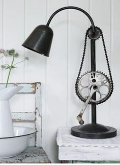 This customised lamp has been cleverly crafted using old bicycle parts and we think it's quite the masterpiece! Recycled Lamp, Recycled Furniture, Repurposed, Recycled Tires, Handmade Furniture, Recycled Materials, Diy Design, Design Ideas, Design Trends