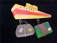 BAKELITE CRUISE SHIP PIN WITH HANGING SUITCASE CHARMS - is it possible to think of Deco without visualising an ocean liner?