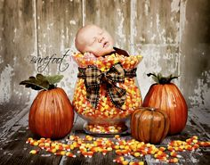Baby with candy corn and pumpkins!!!