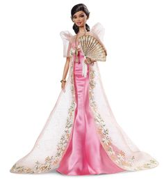 A new Filipina Barbie doll, Mutya Barbie - recalling the glamour of old-school Filipino beauty pageants - has been released by Mattel as part of the brand's ...