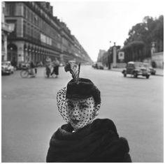 Fashion model with hat on Rue de Rivoli, Paris, 1952, a photo by...