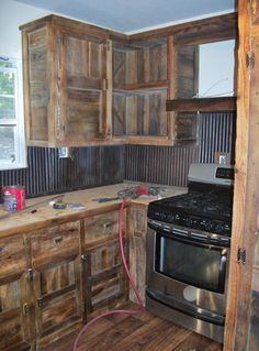 We built these barn wood cabinets and used old tin for a back splash