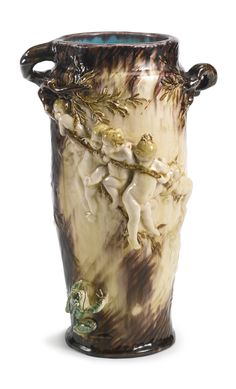 A THÉODORE DECK EARTHENWARE 'LES GRENOUILLES' VASE CIRCA 1890-95 designed by Gustave-Joseph Chéret, decorated in bas relief with putti holding on to branches issuing from the twig-form handles suspended above frogs in a pond, impressed TH.DECK.