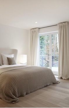 This serene taupe and white contemporary bedroom would be a perfect scheme during the warmer months. This serene taupe and white contemporary bedroom would be a perfect scheme during the warmer months. Bedroom Red, Dream Bedroom, Home Bedroom, Bedroom Furniture, Master Bedroom, Bedroom Decor, Taupe Bedroom, Bedroom Curtains, Calm Bedroom