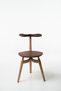 The Trialog Chair is handcrafted and designed for reverse sitting, making the backrest an armrest.