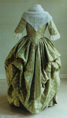 Rear view, robe à l'Anglaise worn à la Polonaise, 1780-1800. Green and cream striped silk brocaded with floral sprays.