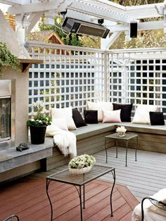 winter-friendly pergola: fireplace, overhead electric heater, stereo speakers and built-in benches. love #pergolafireplace