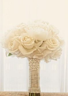 All white wedding bouquet ideas. To see more: www.modwedding.com