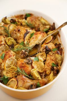 Lemon and Artichoke Oven Roasted Chicken - Crispy, tender lemon-roasted chicken with artichokes and mushrooms makes an easy, elegant dinner! Thecomfortofcooking.com