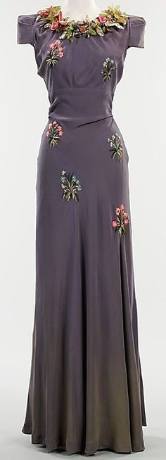 Circa 1930s evening gown embroidered with pink posies and leaves.