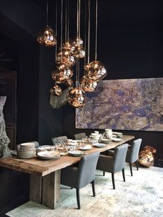 Love the bold dark with the copper, shiny globes mixed with the rustic wood - glamorous yet attainable