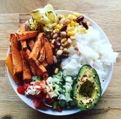 When you don't know what to eat for dinner, just throw everything on the plate, drizzle with sweet chilie sauce and ketchup, and you'll be good to go! Baled cabbage and sweet potato fries, basmati rice, mixed beans, corn, tomatoes, cucumber, springonions and chili sprinkled avo!