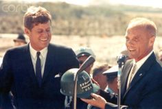 Glenn Giving Hat to President Kennedy Astronaut John Glenn hands a hard hat to President John F. Kennedy at Cape Canaveral in Florida. Several days before, Glenn became the first person to orbit the Earth with the Mercury-Atlas 6 mission.  Date:February 01, 1962 ❋ ❤☀❤☀❤☀❤❋     http://en.wikipedia.org/wiki/John_F._Kennedy