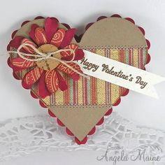 "Cork Button Valentine Heart Card...  Stamps: Hero Arts sentiment  Paper: K & Company striped dp, Recollections Kraft, Paper Source Red and Lux Cream  Ink: Hero Arts ""cup O' Joe""  Accessories: Jute, Crop O Dile, SB scalloped and classic hearts, Sizzix Flower Layers #2 and Flowers & Leaf Bigz die, Sewing machine."