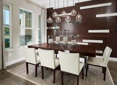 formal dining room. Love the wall idea and lighting.