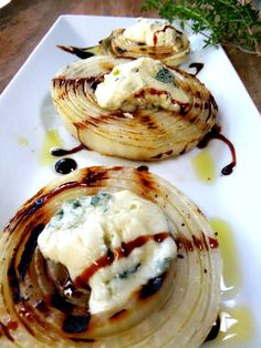 Grilled sweet onions with dollops of warm Gorgonzola and balsamic glaze. Blogger's instructions: just grill slabs of onions that are brushed with olive oil, then remove them with a spatula and place a heaping tablespoon of gorgonzola cheese on top which melts from the warm onion. Finish it off with a drizzle of rich balsamic glaze over the top.