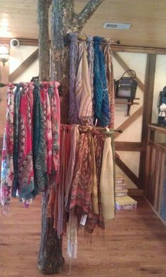 "I had access to a dead tree and a husband who knows how to use a saw. Naturally I introduced one to the other and now I have my own version of this scarf display in my shop. My tree is within 8"" of the ceiling and allows me to display a multitude of scarves in a corner of the store that would normally not get much attention."