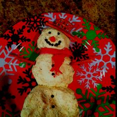Chicken cheeseball snowman with pretzel arms and hat. Dried beef scarf, peppercorn eyes and mouth and a carved carrot nose.