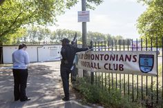 A member of the public talks to a police officer outside Old Edmontonians Football Club in Jubilee Park, Edmonton, following the fatal stabbing of a 29-year-old man. Birthday party guests attending a party at the Old Edmontonians FC clubhouse, sat on the suspected attacker until police arrived following the attack in north London, a witness has claimed. via @AOL_Lifestyle