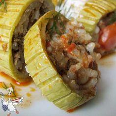 Zucchini stuffed with rice and ground beef   http://giverecipe.com   #zucchini #groundbeef #rice