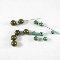 Assortiment de 26 perles miracle/magique vert foncé - 8 et 6mm