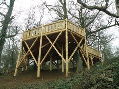 A raised deck set on a hillside overlooking the somerset levels. Built for the use of a local forest school. As the hill drops the far edge of the deck sits 6 meters above ground. The deck is cut to wrap around trees established in the woods. See more of our projects at www.roundwooddesign.co.uk