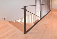 Centerpiece staircase in a modest modern home in Seattle, Washington. Designed and built by BUILD LLC.