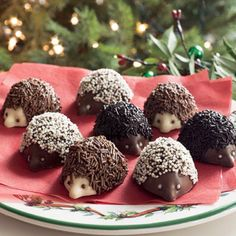 Little hedgehogs treats topped with black and brown jimmies and white non pareil sprinkles.  Great for woodland party!