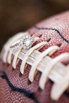 Love this wedding ring on football shot! Athens engagement session on North Campus and Sanford - incorporating football, cheerleading, and the Dawgs! Fun Georgia-themed shoot. By wedding & engagement photographer: Claire Diana Photography