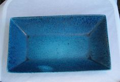 Felix Tissot Blue Matte Splatter Glazed Rectangle Serving Bowl. $98.00, via Etsy.