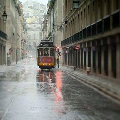 In Lisbon rain. From country Portugal. Trains, Lisbon City, Rain Go Away, Rain Photography, Colour Photography, S Bahn, Going To Rain, Singing In The Rain, Spain And Portugal