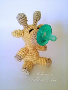 Crochet giraffe  binky buddy stuffed animal by CrochetByWhitneyy
