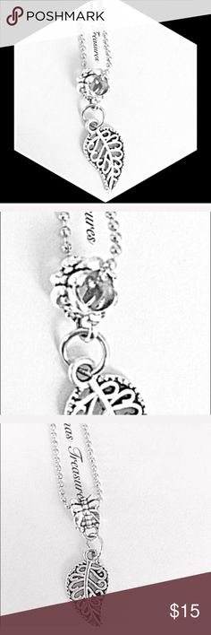 """❄️Silver Leaf Necklace This necklace features an antiqued leaf pendant which measures 1"""" from top to bottom & .30"""" from side to side. It's attached to a decorative ring. The chain is a dainty looking but sturdy dog tag style chain which measures 25"""". The chain is made of stainless steel & the pendant is made of silver over nickel free alloy. Jewelry Necklaces"""