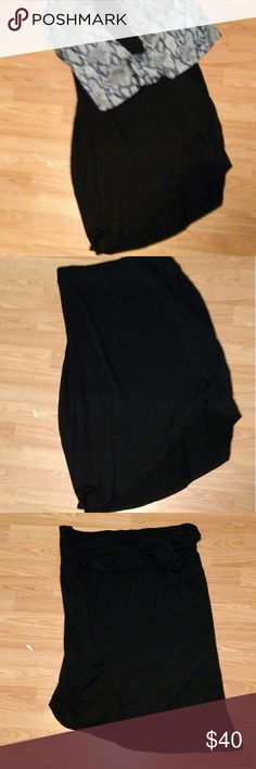 Lane Bryant Black Assymetric Skirt BNWOT. Curved assymetrical side slit, with side ruching above the split. 95% rayon, 5% spandex. Elasticized waist. Tagged 26/28 Lane Bryant Skirts