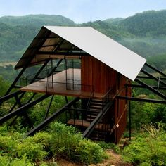Raised up by a framework of slender steel supports, this wooden bungalow offer a vantage point over a Sri Lankan rubber plantation and the jungle beyond Tropical Architecture, Roof Architecture, Bungalow, Casas Containers, Forest House, Roof Design, Tropical Houses, Home Look, Luxury Houses