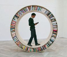 Installation art by David Garcia - Instead of stuffing books into dense shelves, why not let them roll and move around?