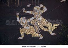 Mural painting on the walls of Emerald Buddha Temple in Bangkok, Thailand - Stock Photo