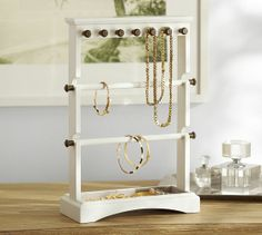 Andover Jewelry Tree from Pottery Barn. This is a stylish solution to the problem of making my favorite jewelry pieces easily accessible. Fourteen pegs (seven on each side) for hanging necklaces, removable rods for bracelets, and a linen lined bottom tray for watches and rings. It has TONS of storage that's all out in the open so you can find what you need at a glance.