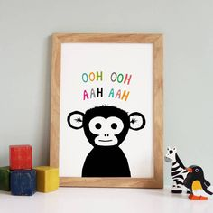 This monkey print looks fantastic on its own or as part of a zoo nursery print series. A black monkey with colourful lettering on a white background. They look fantastic on their own or hung as part of a set. To view co-ordinating prints click here